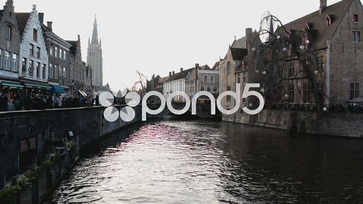 Canal in Bruges, Belgium. Hazy sunshine view of large church steeple. With sound - Stock Footage | by glenman77