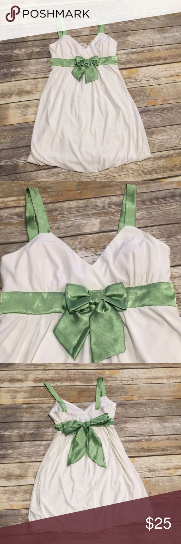 White and green mini dress White and green mini dress,92% polyester, 8% spandex, satin bow front tie bow in the back, satin strap, bunched bottom dress. Taboo Dresses Mini