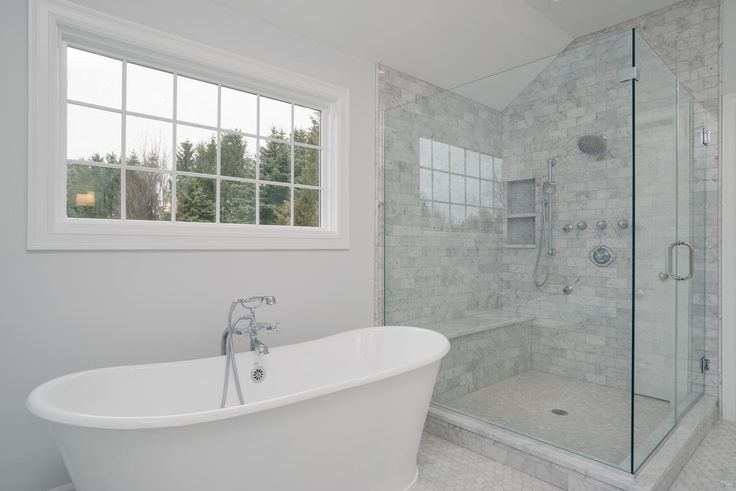 This luxurious white tiled bathroom is so gorgeous! We here at Forbes Capretto Custom Homes are very proud of it.