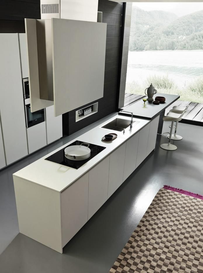#Functional Everything has its place and is perfectly organised: the wall is FInished with open niches that create a play of light and shadow, adding a harmonious touch to the environment. Last but not least, functionality is the keyword. #designkitchen http://www.modulnova.com/project-project-14