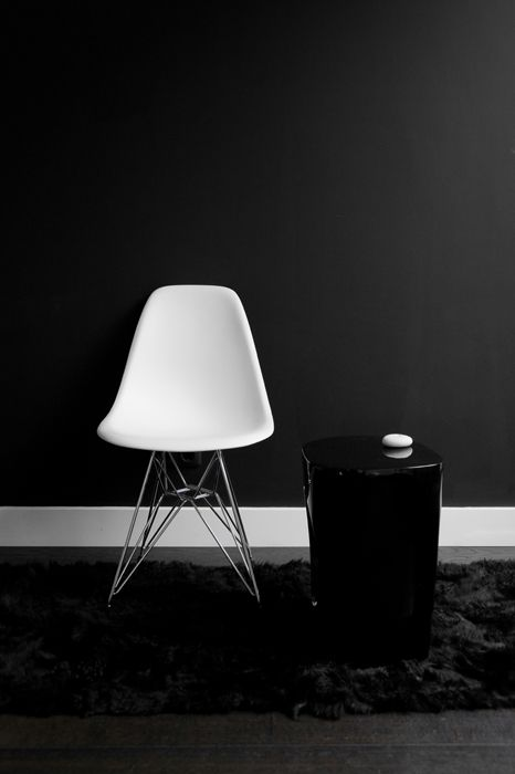 chair and black wall