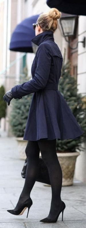 Flared navy winter peacoat with black tights and heels.