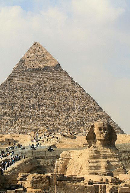 The Great Pyramid of Giza is shown above. After taking about 20 years to build, it is the largest and oldest of the Seven Wonders of the Ancient World. The pyramid was the tallest man-made structure in the world for almost 4,000 years and is guarded by a sphinx.