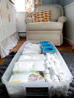 Under crib storage idea - diapers and diaper pail refills. Could also store sheets and towels and blankets. Love this idea.