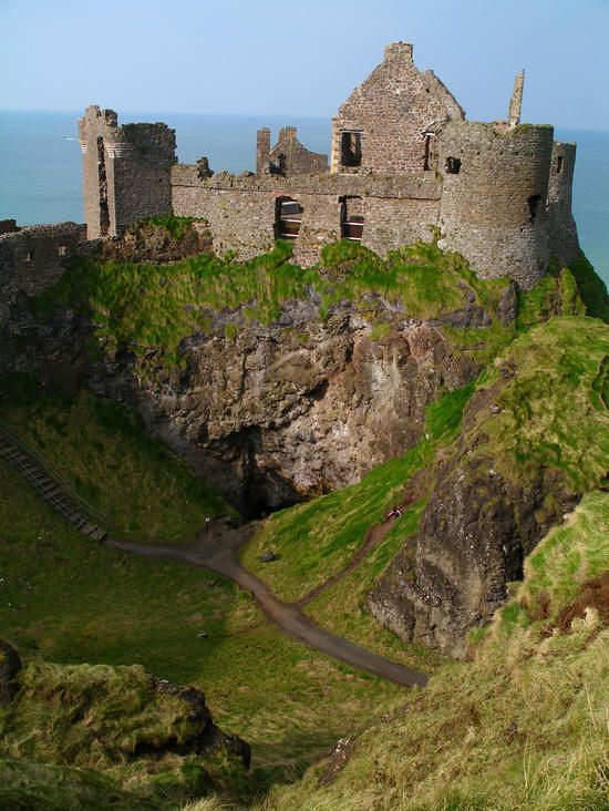Dunluce Castle, Belfast Ireland. Adam and I have been here and walked down those stairs and climbed into the cave just under the castle! It is GORGEOUS!