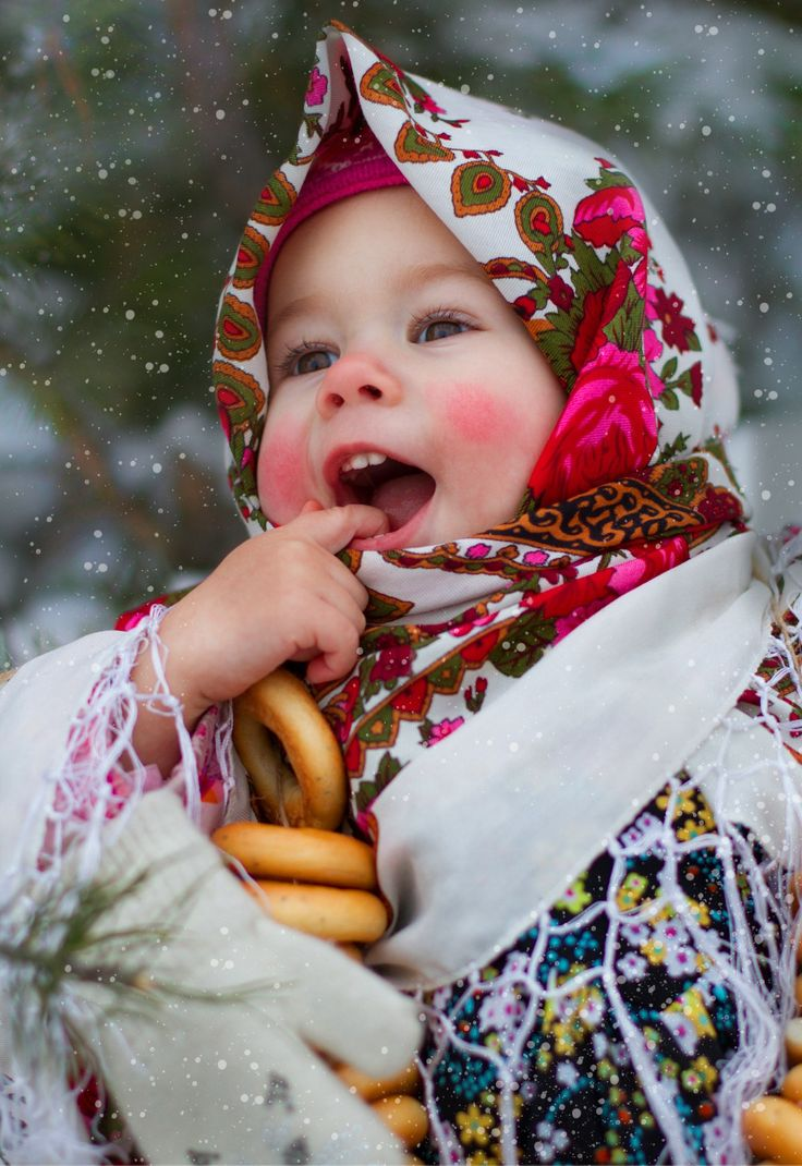A cute little girl in the Russian traditional shawl with bright floral patterns. #cute #kids #Russian #folk