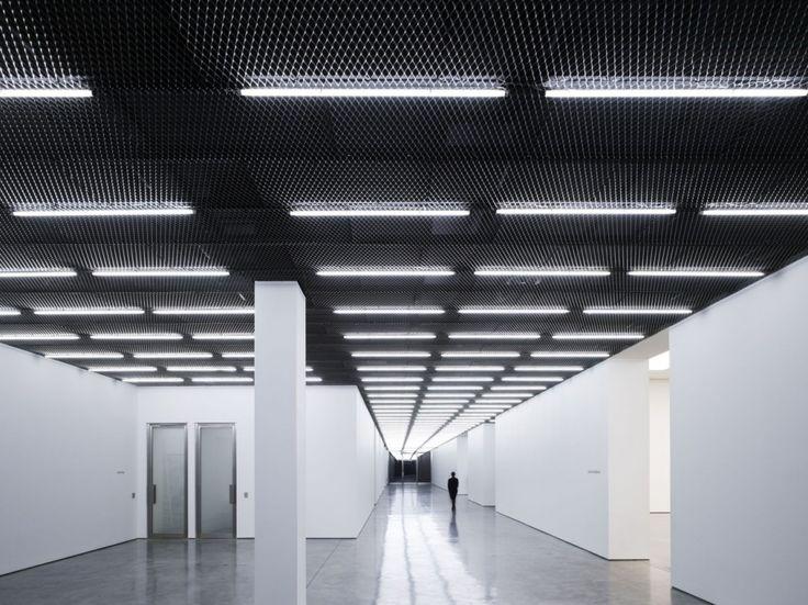 Ceiling Tube Light: Casper Mueller Kneer Architects / White Cube Bermondsey. More tube lighting  against textured ceiling (,Lighting