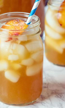 Peach Tea Punch-A refreshing and summery punch is perfect for a hot day (and even better with fresh summer peaches). Unique idea for baby and wedding showers too. Simple sugar syrup, ginger al and pureed fresh fruit peaches makes this beverage so delicious, your party and picnic guests will ask for a refill before you put the pitcher back! This drink will keep you cool throughout the hottest months, but is so good you'll keep drinking it until the fall.