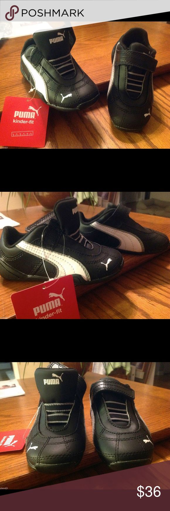 Puma Kinder-fit Sport Shoes Toddler 7 Puma Kinder-Fit Athletic Shoes. Toddler size 7  Just like the big boys shoes. Wide spacing for little toes. Velcro closing strap. Leather uppers with rubber soles and textile lining. Puma Shoes Sneakers