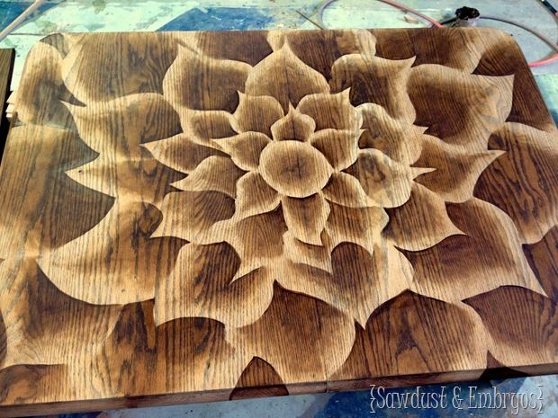 Ombre tain technique.  Apply stain to petal pattern and wipe off from outside of petal into center.  Works by wiping some stain off immediately. The longer it's left on the darker it gets by gradually wiping and darkening each petal of the flower as you remove stain.  Stripping furniture and unique staining technique! {Sawdust and Embryos}
