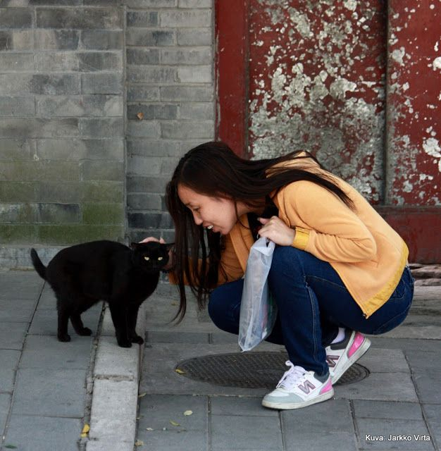 Girl and black cat in Peking.