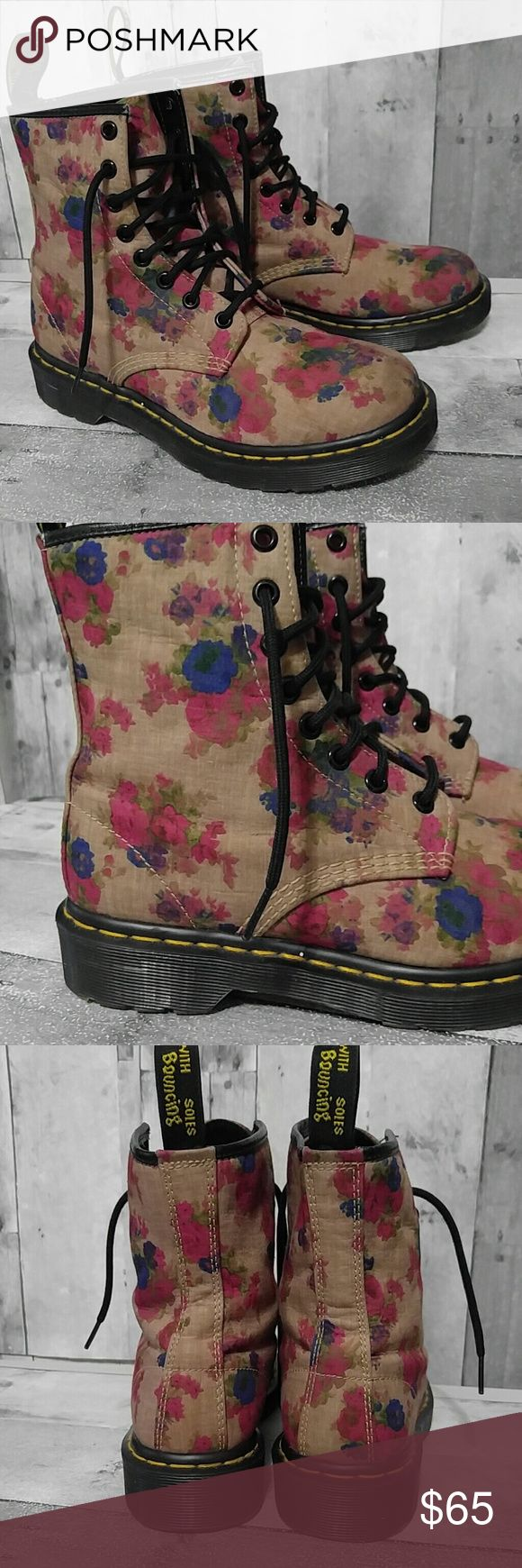 Floral Doc Dr. Martens Castel 8 eye Boots US 7 8 eyelet Doc Martens floral combat boots. Very gently pre owned with nearly perfect condition - small spot on one toe you can barely see. Bottoms perfectly clean. made in Thailand  Beautiful floral tan with red, blue and greens. Love these boots !!!! US 7, EU 38 & UK 5.  ** no trades** Dr. Martens Shoes Combat & Moto Boots