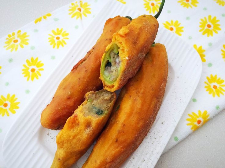 Mirchi Bada is a famous Indian snack of chilli from the state of Rajasthan. The bigger variety of chillies are used for this recipe. The chillies are stuffed with a wonderful tangy potato mix then dipped into the chickpea batter and then fried. It makes for a delicious snack to be had withthe evening tea. Serve theMirchi Bada Recipe along with green chutney and hot ginger/masala tea for a tea time snack over the weekend. If you like this recipe try other fritter recipes Sabudana Vada Recipe…