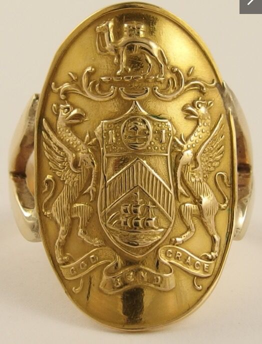 An 18ct heraldic signet ring (no intaglio) by William Hair Haselar  hallmarked Birmingham 1911 WHH, the creata is for the Creighton Family with both elements of the Glasgow coat of arms