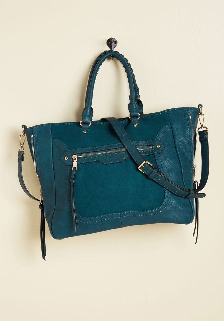 With errands to achieve in various parts of the city, what's a gal to do? Get organized and grab this faux-suede bag, that's what! A chic companion with its handy front pocket, faux-leather accents, and zipped sides for added structure, this satchel expertly aids in every part of your mission.