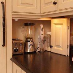 A cool hideaway for small kitchen appliances. Keeps them handy but hidden. #HomeAppliancesKitchen #Appliances