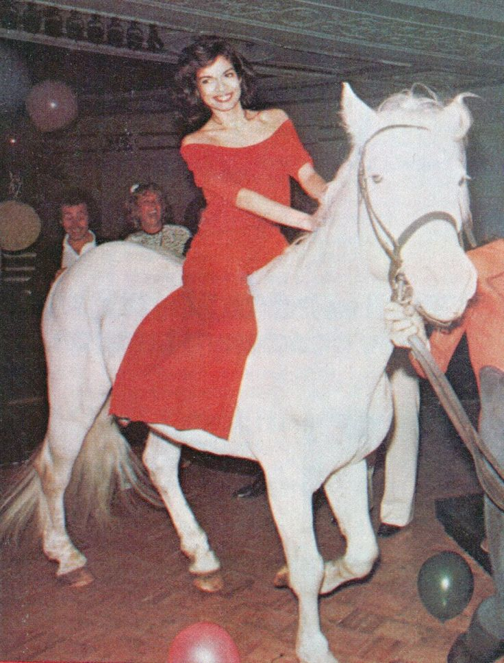Bianca Jagger at her 30th birthday party at Studio 54, 1977!!!!! Red dress. Comes with horse.