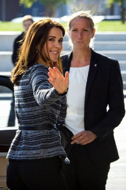 Crown Princess Mary waves during her visits to the Koglehuset daycare centre in Holstebro on 03.10.13.