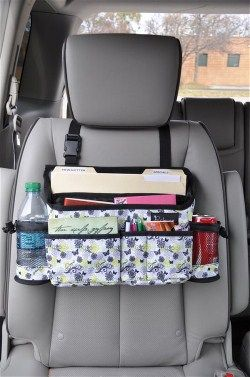 Swing Away - Who couldn't use a little extra space in their car? Slip the adjustable strap over any car seat and you'll instantly create just that! Swing this carrier to the front side of the passenger seat for those who need an office on the go!