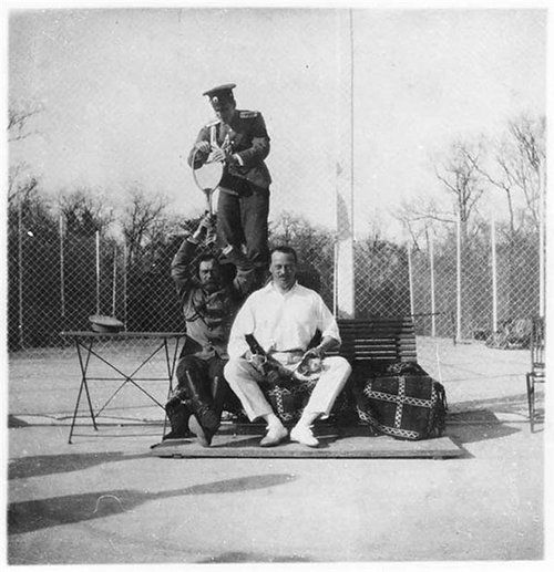 Nicholas was known to have a relaxed playfulness that he encouraged with  friends & family.  It is evident in this photo taken at the Peterhof tennis courts.  Dmitry Pavlovich, a younger cousin of the Tsar is standing.  Ernie, (Alex's brother) is seated next to the Tsar.  Dmitry was one of the assassins of Rasputin. It deeply hurt Nicholas when he discovered that Dmitry was part of the murder.  He had been a very close mentor to Dmitry thoughout his youth & young adult life.