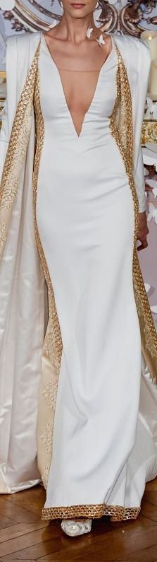 "Alexis Mabille couture - I ""think"" I like this dress? Can't tell if the gold weighs it down or is too stiff. Love the cape/jacket with the broad shoulders."