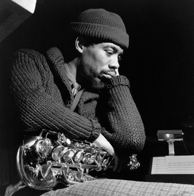 Eric Dolphy, jazz musician, clarinetist & sax player, concentrating on the music