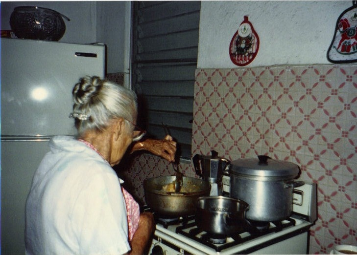 """Mami en la cocina""  My mother never measured , never used a cookbook.   I miss her arroz con pollo, and the Puerto Rican pasteles that she would make at Christmas."