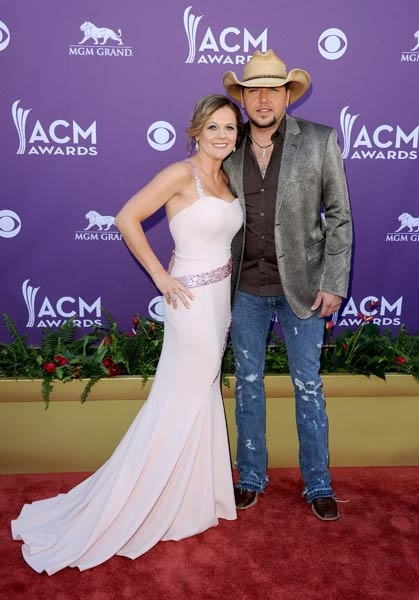 Jason Aldean and wife Jessica on the red carpet at the 2012 ACM Awards via CMT.com (Jason Merritt/Getty Images)
