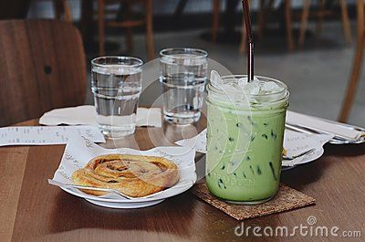 Stock Photo about Ice green tea and Cinnamon Chip the table