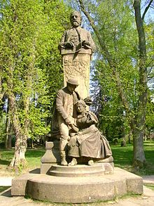 "First Bedřich Smetana, monument, unveiled in Hořice 1903, the work of Maurice Blacken. Under Smetana statue is scene of ""faithful love"" from The Bartered Bride"