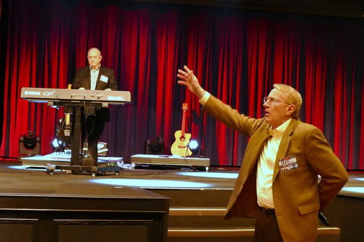 PCCNA President Jeff Farmer opens a meeting with prayer. Assemblies of God Assistant General Superintendent Alton Garrison led worship for the meeting.