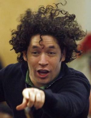 Gustavo Dudamel in full conductor mode. It's all about the curly hair....