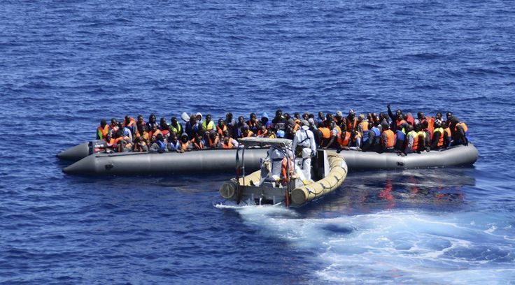 Migrants sit in their boat during a rescue operation by Italian Navy vessels off the coast of Sicily Three separate shipwrecks in the Mediterranean south of Italy in recent days are thought to have claimed the lives of more than 700 people, officials from the UN's refugee agency said.