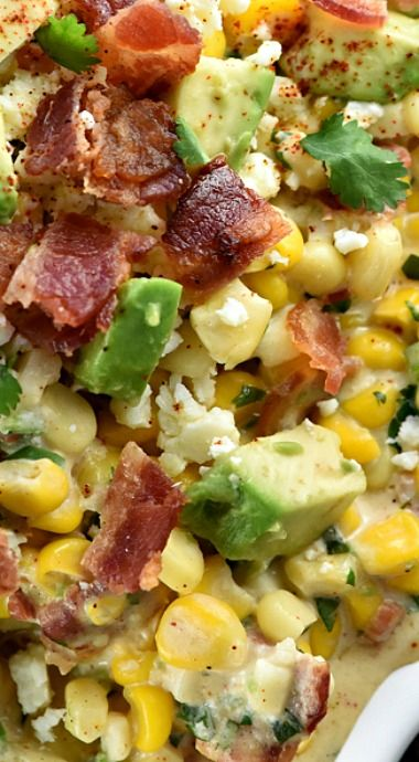 Ultimate Mexican Street Corn Dip ~ warm, creamy, and loaded with a mouthwatering combo of ingredients...corn, cotija cheese, avocado, bacon, jalapeños, cilantro, and chipotle chile powder for the perfect amount of smoky heat...ideal for Superbowl, game day, or just about any party or get-together!