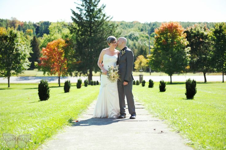 Guelph Wedding Photography at the Wellington County Museum in Fergus. Bride and Groom fall portrait