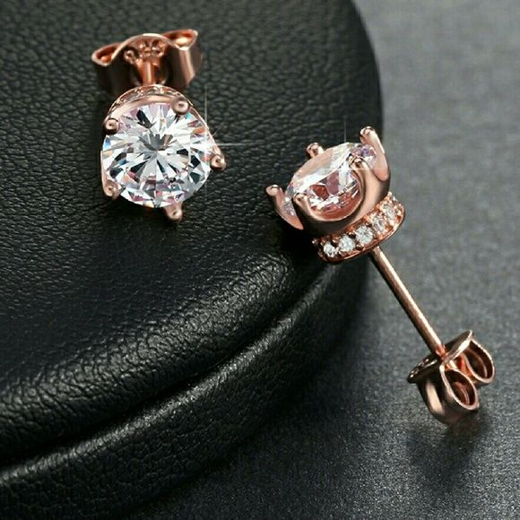 18k Rose Gold Simulated Diamond Stud Earrings Elegant 18k Rose Gold Plated 4mm 0.8 ct Simulated Diamond set in 925 Sterling Silver Stylish Trendy Fashion Push-Back Stud Earring.  100% Lead and Nickel Free.  ~Comes With Velvet Pouch~ Jewelry Earrings