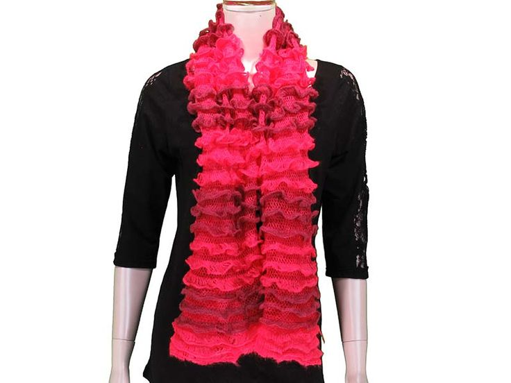 Coral This Ruffled Tube Scarf  can be worn as a shorty infinity, or as a long scarf.  Ruffled layers provide extra softness and lightness to the scarf, with beautiful colours to match any outfit! Available in Black, White/Grey, Pink, Coral, Red, Mint, Royal.