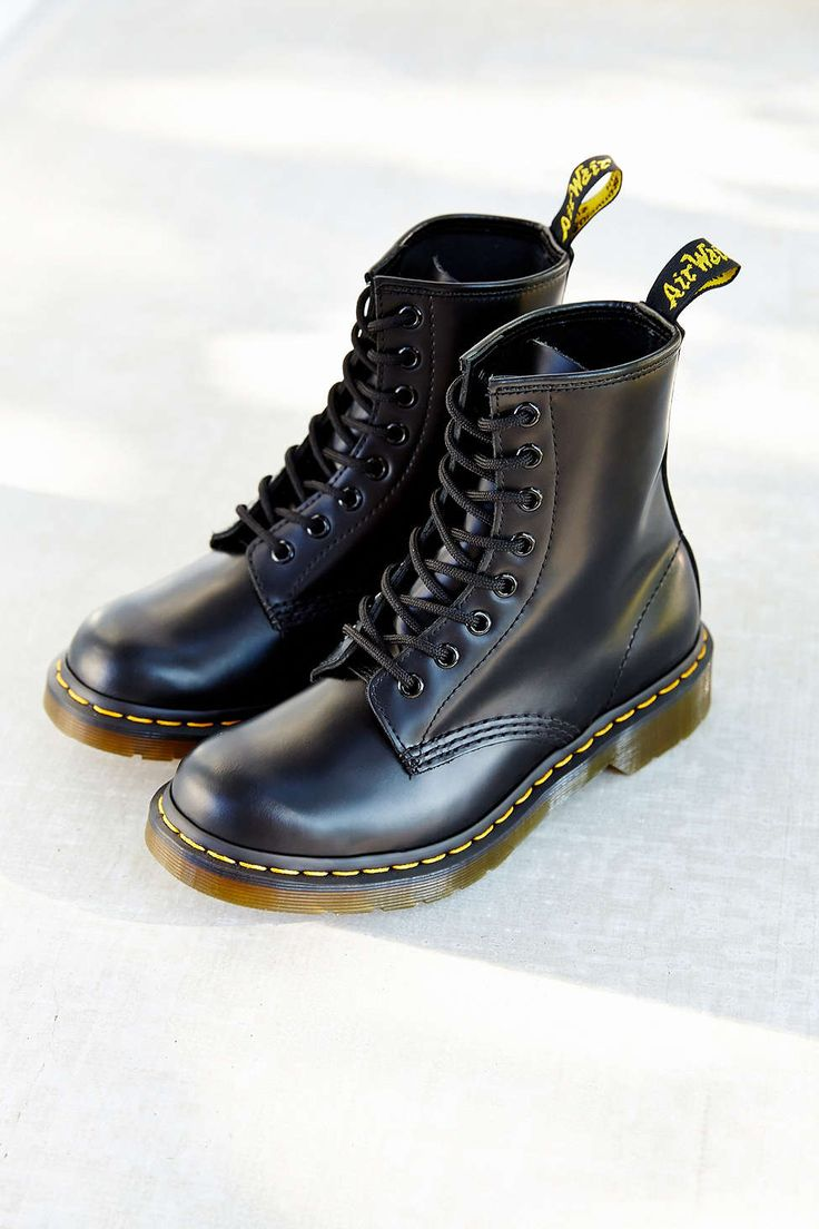 Dr. Martens are mine in black and flowered. I wear lace socks that I fold over the top with them - brings in the feminine and softens the edge.