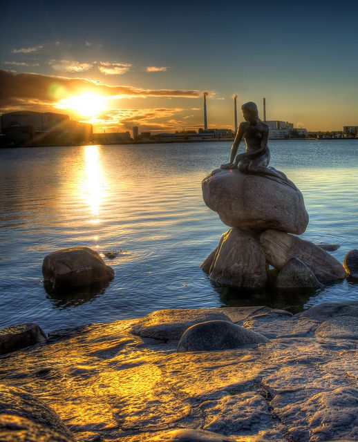 "One of Copenhagen's most famous tourist attractions is ""The Little Mermaid"" sitting lonely and longing on top of a rock at Langelinie. She reminds us of the fairy tale by Hans Christian Andersen about a mermaid who is prepared to give up her life under water for the love of a prince."