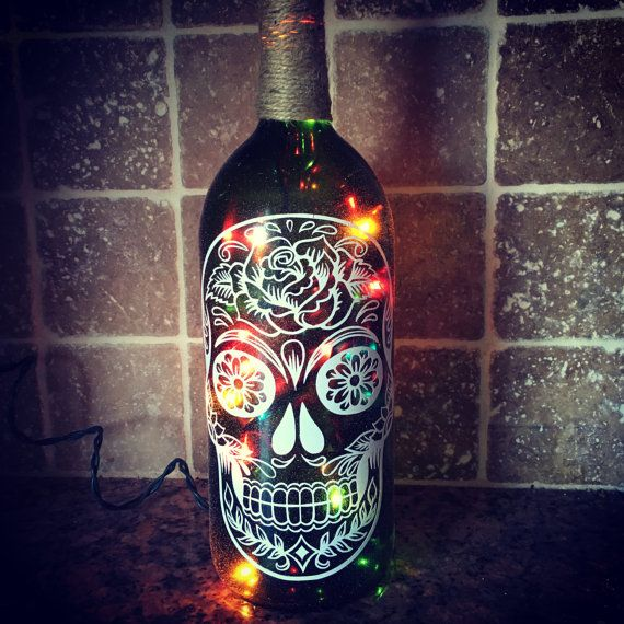 Hey, I found this really awesome Etsy listing at https://www.etsy.com/listing/259781352/sugar-skull-wine-bottle-light