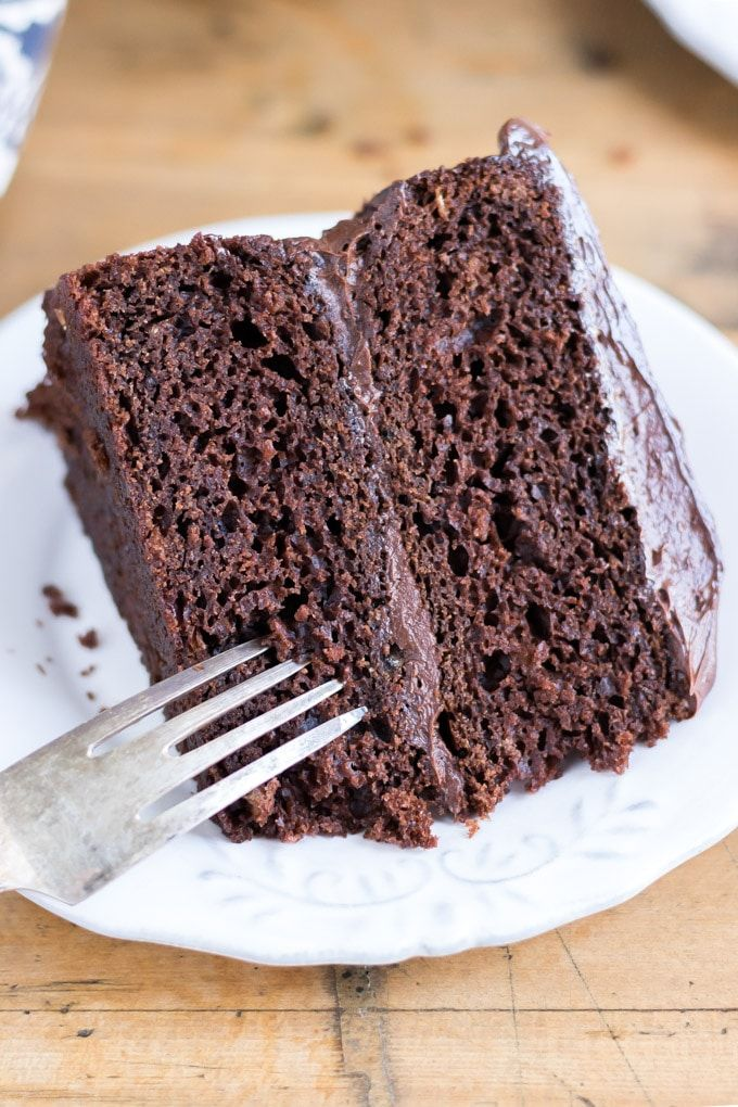 Close Up Of A Slice Of Two Layer Chocolate Vegan Cake On A White Plate With Vintage Vegan Chocolate Cake Vegan Chocolate Cake Easy Vegan Chocolate Cake Recipe