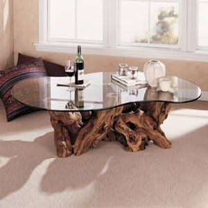 unique tree root table with glass top.  Saw one like it Savannah, GA.   Beautiful