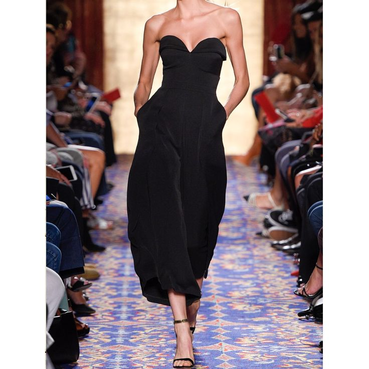 <p>The Bustier Jumpsuit with pleats in black from <strong>Brandon Maxwell. </strong>Crafted from<strong> </strong>suiting fabric jumpsuit and featuring a pleated sweetheart neckline and bustier-style bodice. Nips in at natural waist and has pleated, wide legs with hems cropped above the ankles and hidden back zip.<br />Viscose.<br /><br />Made in the United States<br /><span>Style ID: JS008</span...