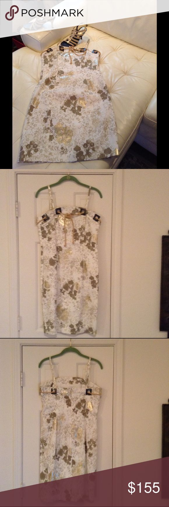 DONNA DEGNAN Summer Dress This dress says WOW !!! White w/Gold foil like high gloss flowers . Form fitting can be worn w/ spaghetti straps or they can be removed has stays in it for security and great look either way . Metal grommets around neckline w/ shinny gold rope ,ties in front .hidden zipper & is fully lined .Shown w/Gold Donald J Pliner for sale in a Separate listing. Worn once for just a few hours . DONNA DEGNAN Dresses Strapless