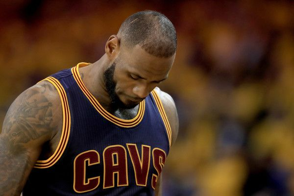 LeBron James Photos Photos - LeBron James #23 of the Cleveland Cavaliers reacts during Game 1 of the 2017 NBA Finals against the Golden State Warriors at ORACLE Arena on June 1, 2017 in Oakland, California. NOTE TO USER: User expressly acknowledges and agrees that, by downloading and or using this photograph, User is consenting to the terms and conditions of the Getty Images License Agreement. - 2017 NBA Finals - Game One