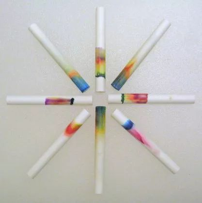 These chalk chromatography examples were made using chalk with ink and food coloring.