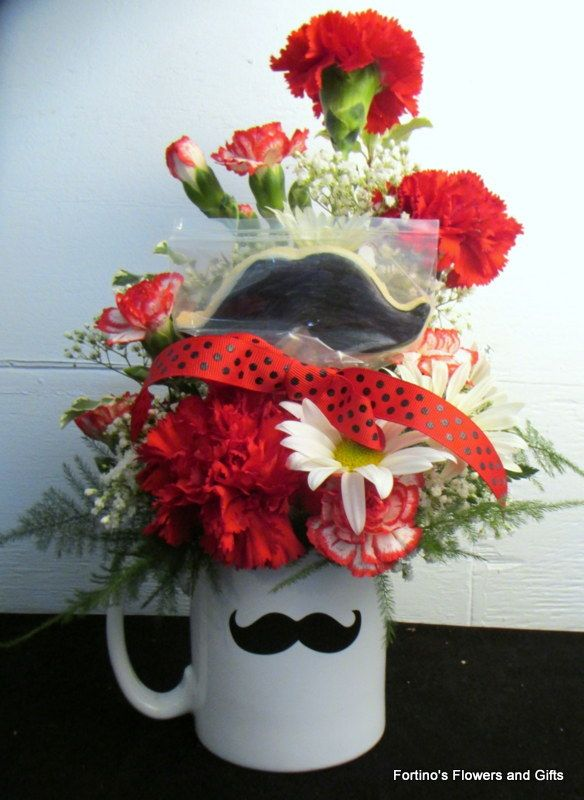 Mustache cookie by yours truly!!! (http://www.fortinosflowers.com/mustache-mug/)