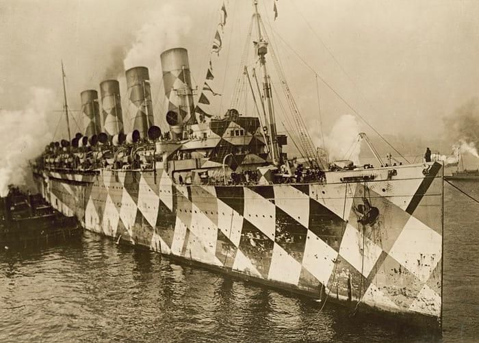 The RMS Mauretania with dazzle camouflage in 1915. This method of camouflage was used on battleships and transports to deceive U-Boat commanders and make correct aim difficult. [700  501]