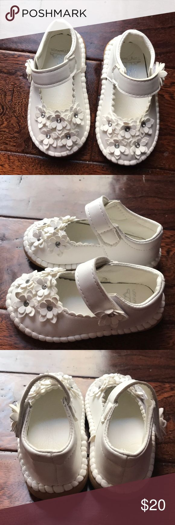 White toddler shoes Super cute white flower toddler shoes size 24 months. I would say they are close to a toddler size 7..  The length of the shoes are about 6 inches and the width is about 3 inches.  These shoes are brand new and never been wore! Shoes
