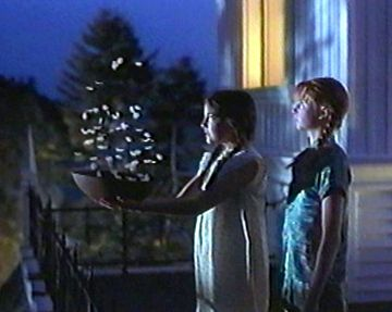 """Camilla Belle and Evan Rachel Wood portrays the characters of Sally and Gilly in the movie """"Practical Magic"""". their watching the """"Amas Veritas' spell work its magic....."""